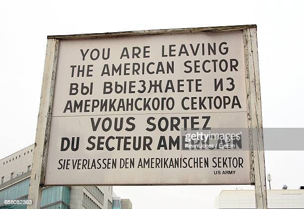 low angle view of information sign - checkpoint charlie stock photos and pictures
