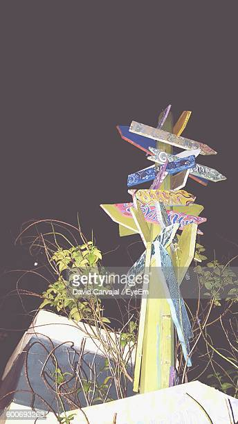 low angle view of information signs against sky at night - carvajal stock photos and pictures