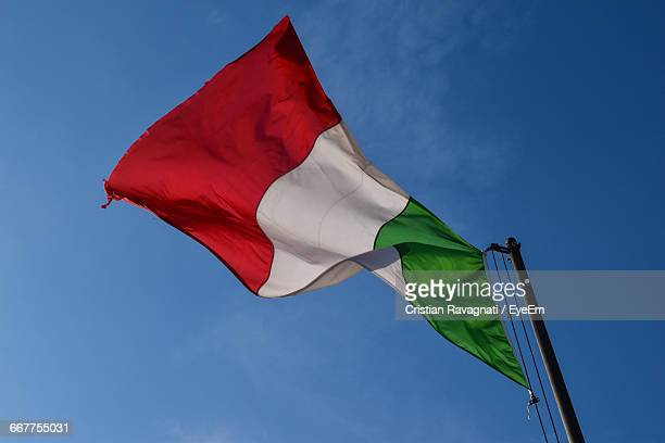low angle view of italian flag against sky - italian flag stock pictures, royalty-free photos & images