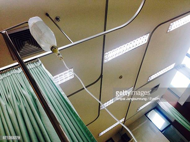 Low Angle View Of Iv Drip Against Ceiling
