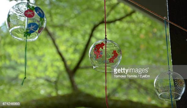 Low Angle View Of Japanese Wind Bell Hanging On Rope