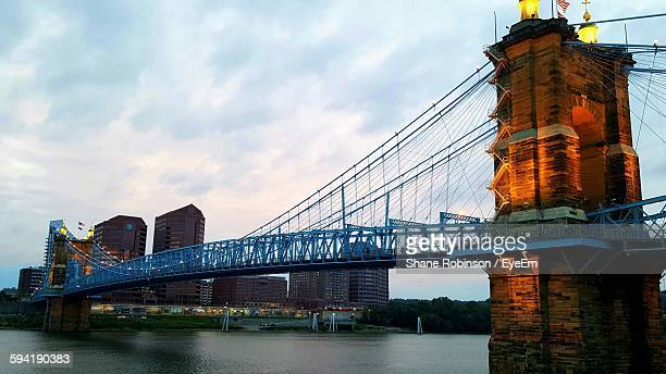 low angle view of john a roebling suspension bridge against cloudy sky - cincinnati stock pictures, royalty-free photos & images
