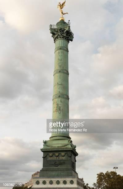 low angle view of july column against cloudy sky at place de la bastille, paris, ile de france, france, europe - monument stock pictures, royalty-free photos & images