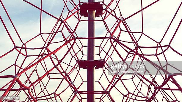 Low Angle View Of Jungle Gym At Playground Against Sky