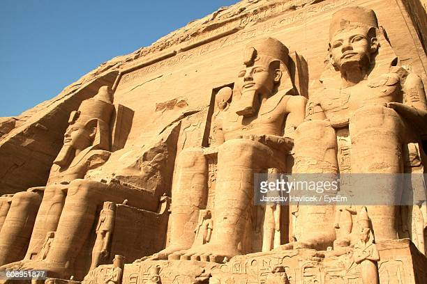 low angle view of king sculptures at abu simbel temple - abu simbel stock pictures, royalty-free photos & images