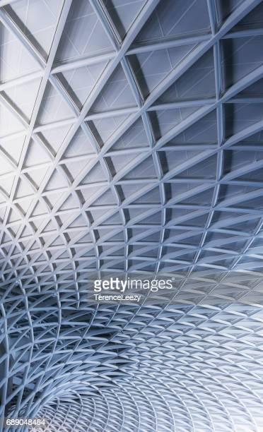 low angle view of kings cross station, london - architektonisches detail stock-fotos und bilder