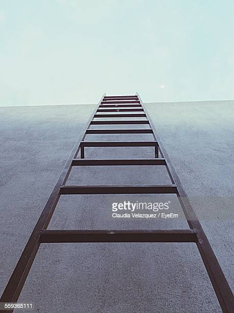Low Angle View Of Ladder Leading Towards Clear Sky