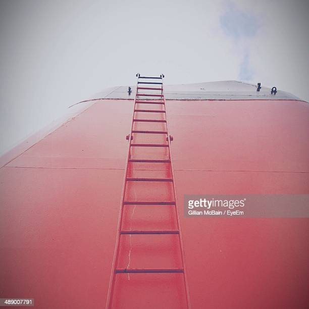 low angle view of ladder on ship funnel against cloudy sky - ship funnel stock photos and pictures