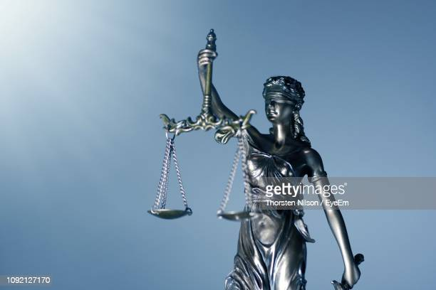 low angle view of lady justice against clear blue sky - lady justice stock pictures, royalty-free photos & images