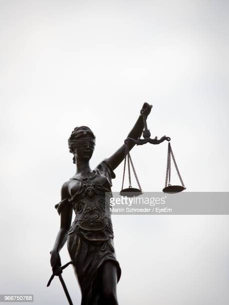 low angle view of lady justice against clear sky - lady justice stock pictures, royalty-free photos & images