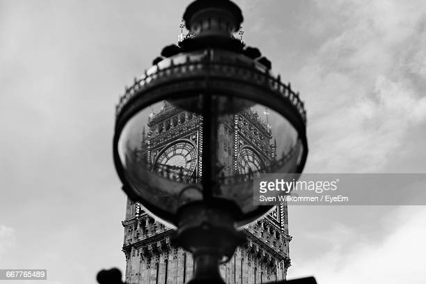 Low Angle View Of Lamp Post Against Big Ben In City