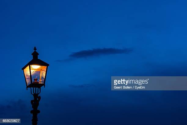low angle view of lamp post against sky - ガス燈 ストックフォトと画像