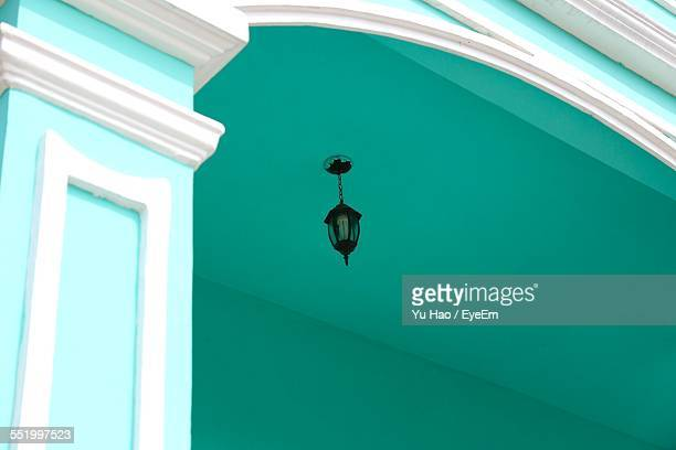 Low Angle View Of Lantern Hanging With Ceiling
