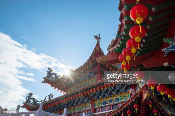 low angle view of lanterns hanging at temple during chinese new year - shaifulzamri eyeem stock pictures, royalty-free photos & images