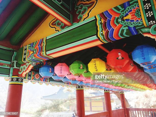 low angle view of lanterns hanging on wall - casey nolan stock pictures, royalty-free photos & images