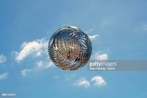 low angle view of leaf patterned ball against blue sky - wellington new zealand stock pictures, royalty-free photos & images