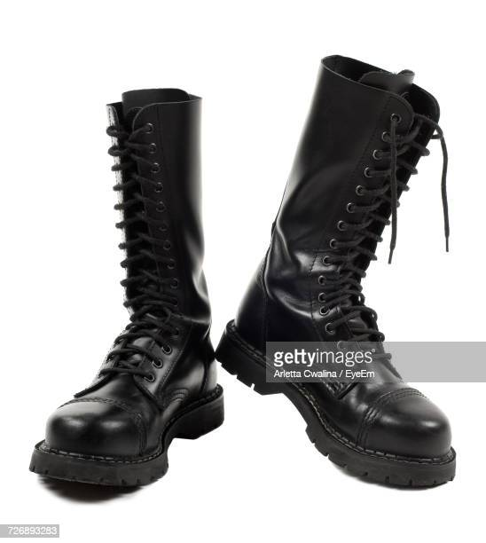 low angle view of leather boots - black boot stock pictures, royalty-free photos & images