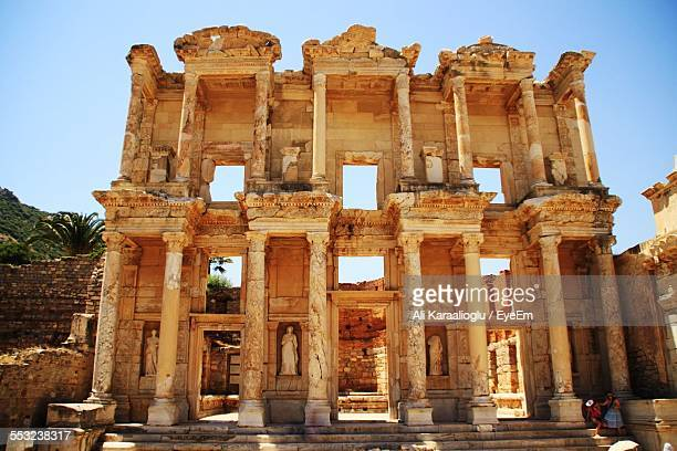 low angle view of library of celsus against clear sky - izmir stock pictures, royalty-free photos & images