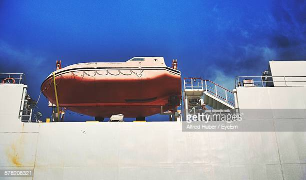 Low Angle View Of Lifeboat In Ship Against Blue Sky