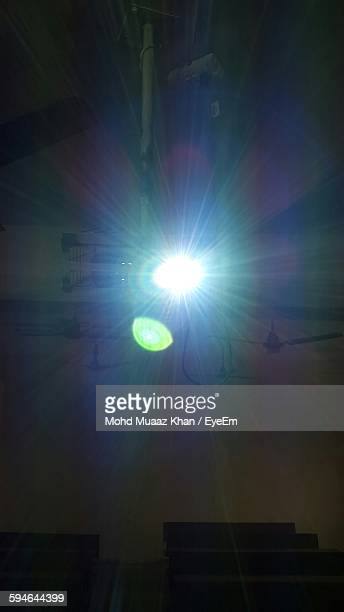 Low Angle View Of Light Beams From Projector