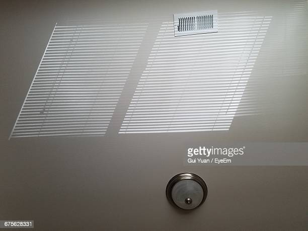 Low Angle View Of Light Fixture On Ceiling