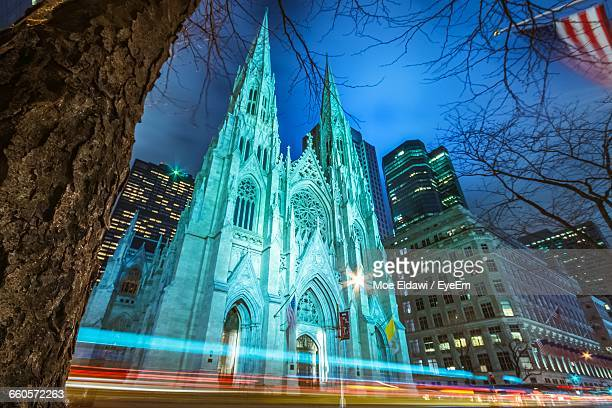 low angle view of light trail by st patrick cathedral - st. patricks cathedral manhattan stock photos and pictures