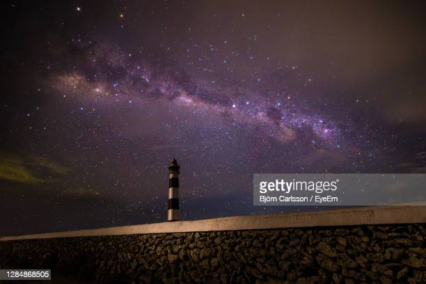low angle view of lighthouse against sky at night - astronomy stock pictures, royalty-free photos & images