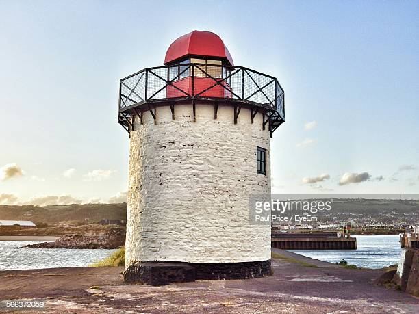 low angle view of lighthouse against sky - llanelli stock pictures, royalty-free photos & images