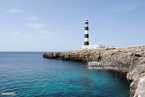 Low Angle View Of Lighthouse At By Sea At Minorca