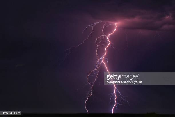 low angle view of lightning against sky at night - lightning stock pictures, royalty-free photos & images
