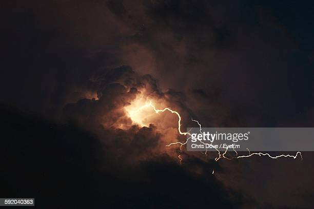 low angle view of lightning against storm clouds - extreme weather stock photos and pictures