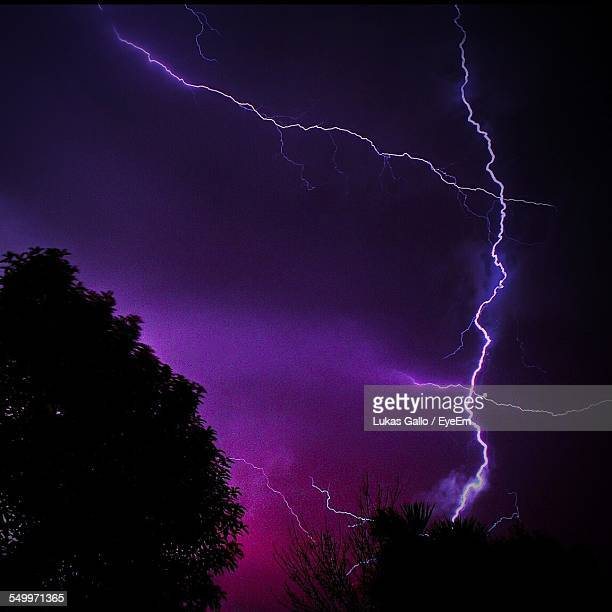 Low Angle View Of Lightning In Dramatic Sky At Night