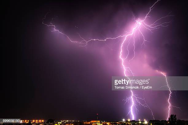 Low Angle View Of Lightning In Sky At Night