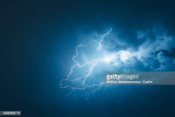low angle view of lightning in sky - lightning stock pictures, royalty-free photos & images