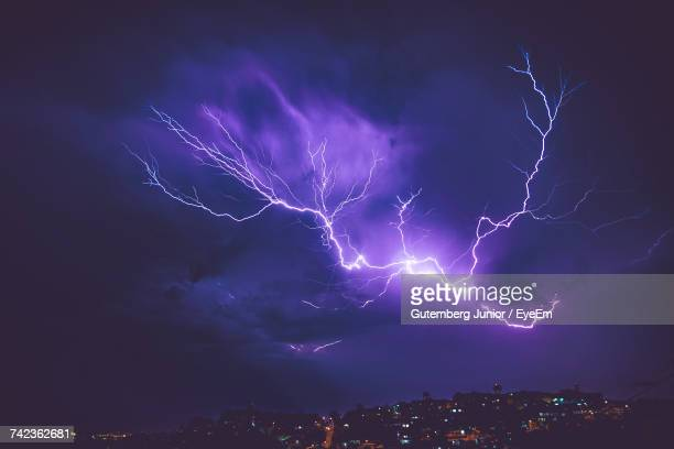 Low Angle View Of Lightning Over City At Night