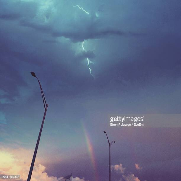 Low Angle View Of Lightning Over Street Lights