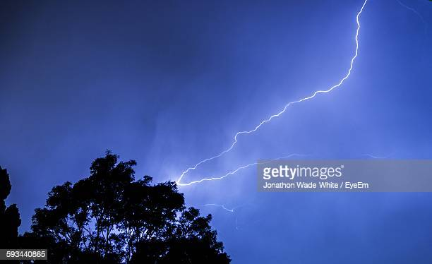 Low Angle View Of Lightning Strike Against Blue Sky