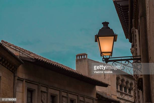 Low angle view of lit sconce outdoors