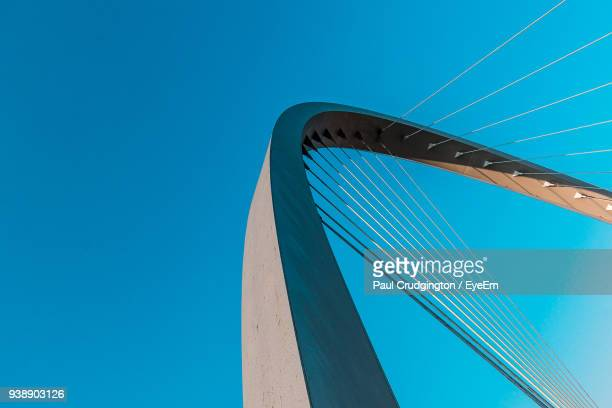 low angle view of lowry avenue bridge against clear blue sky - suspension bridge stock pictures, royalty-free photos & images