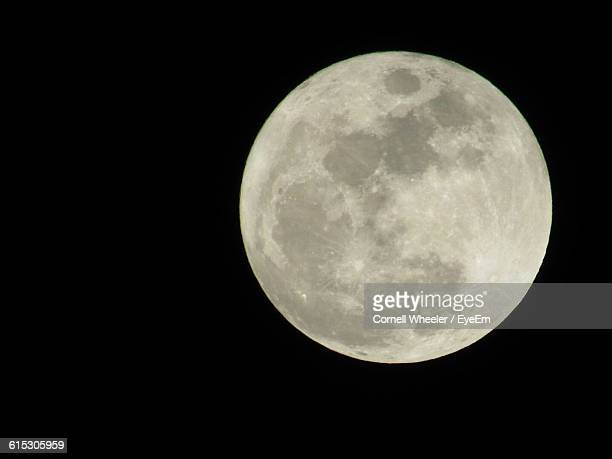 Low Angle View Of Majestic Full Moon In Clear Sky At Night