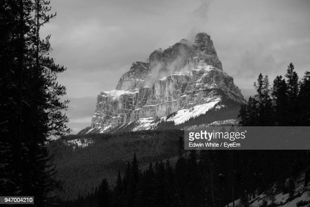 low angle view of majestic mountains against sky - castle mountain stock photos and pictures