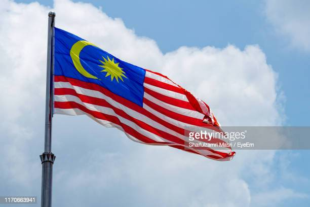 low angle view of malaysian flag against sky - shaifulzamri eyeem stock pictures, royalty-free photos & images