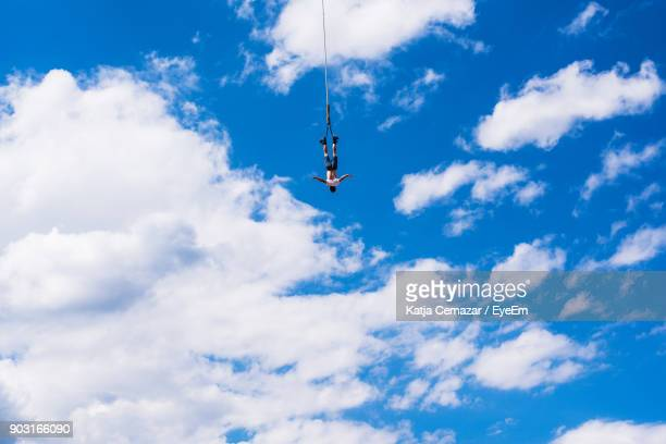 Low Angle View Of Man Bungee Jumping Against Sky