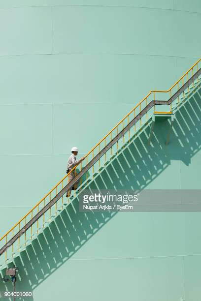 Low Angle View Of Man Climbing On Steps