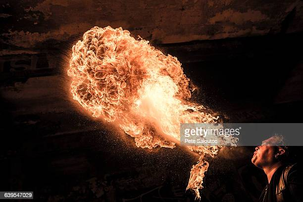 Low angle view of man fire breathing