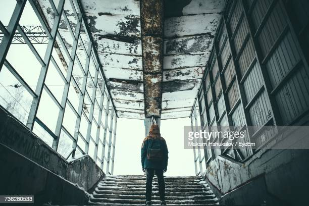 Low Angle View Of Man In Abandoned Building