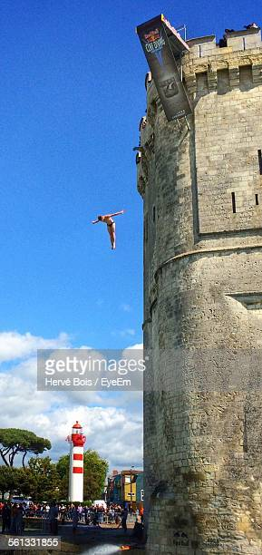 Low Angle View Of Man Jumping From Tour St-Nicolas For Cliff Diving World Series