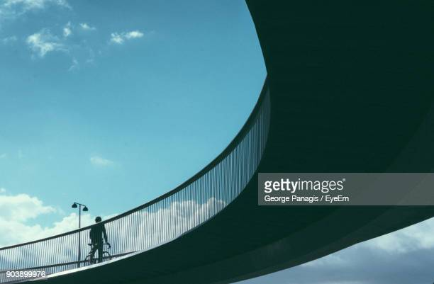 low angle view of man on bridge against sky - copenhagen stock pictures, royalty-free photos & images