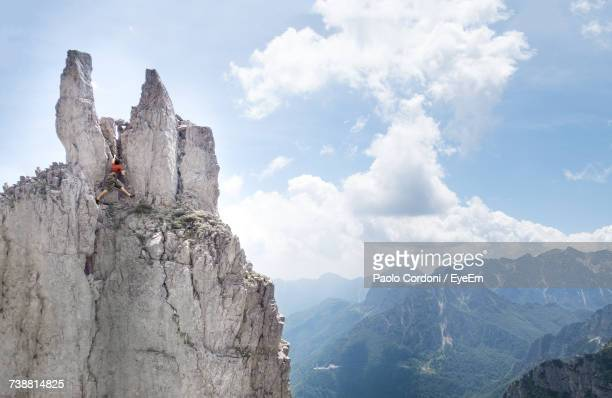 Low Angle View Of Man On Cliff Against Sky