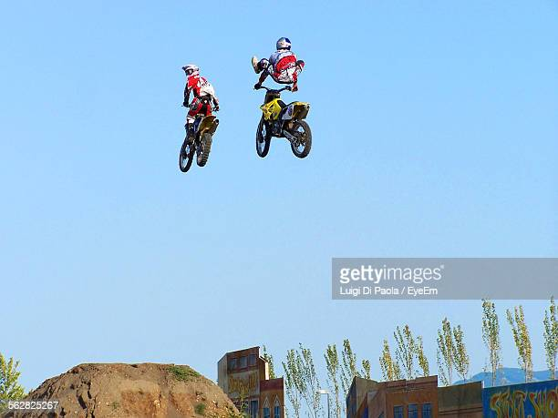 Low Angle View Of Man Performing Stunt Against Clear Sky